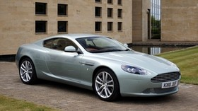 aston martin, db9, 2010, metallic blue, side view, style, sport, aston martin, auto, building, grass - wallpapers, picture