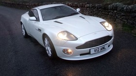 aston martin, v12, vanquish, 2004, white, front view, aston martin, nature - wallpapers, picture