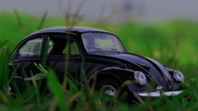 car, retro, typewriter, toy, grass - wallpapers, picture