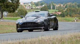 mansory cyrus, 2009, black, front view, style, aston martin, houses, trees, asphalt - wallpapers, picture